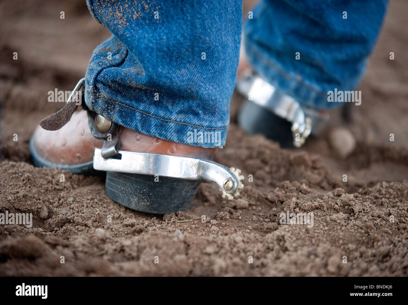 A pair of spurs on a child's boots at the rodeo. - Stock Image