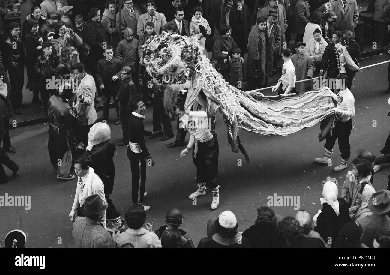 Group of people watching a dragon on the eve of Chinese New Year, Chinatown, Manhattan, New York City, New York, - Stock Image