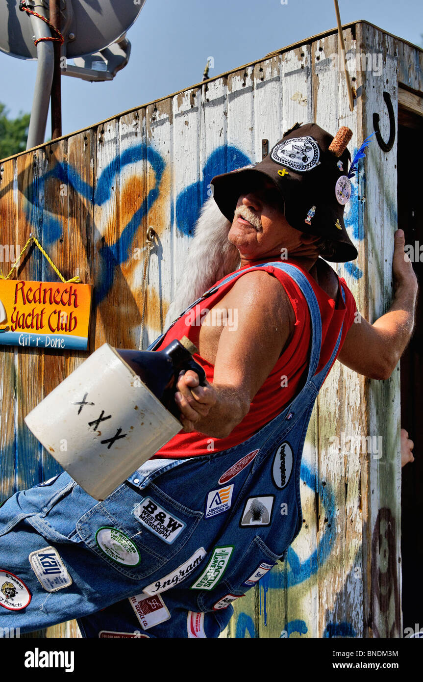 Man with Jug of Moonshine on Hillbilly Float in Oldest Continuous Independence Day Parade in America in New Pekin, - Stock Image