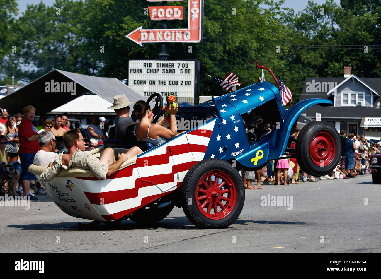 Patriotic Wheelie Car in Oldest Continuous Independence Day Parade in America in New Pekin, Indiana - Stock Image