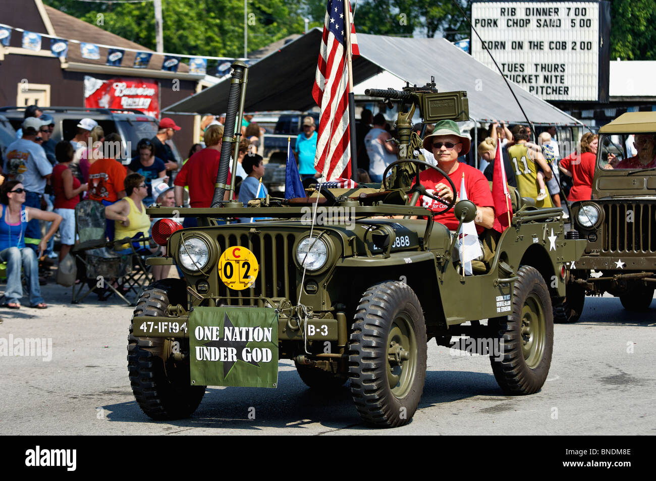 Man Driving Old Army Jeep in Oldest Continuous Independence Day Parade in America in New Pekin, Indiana - Stock Image