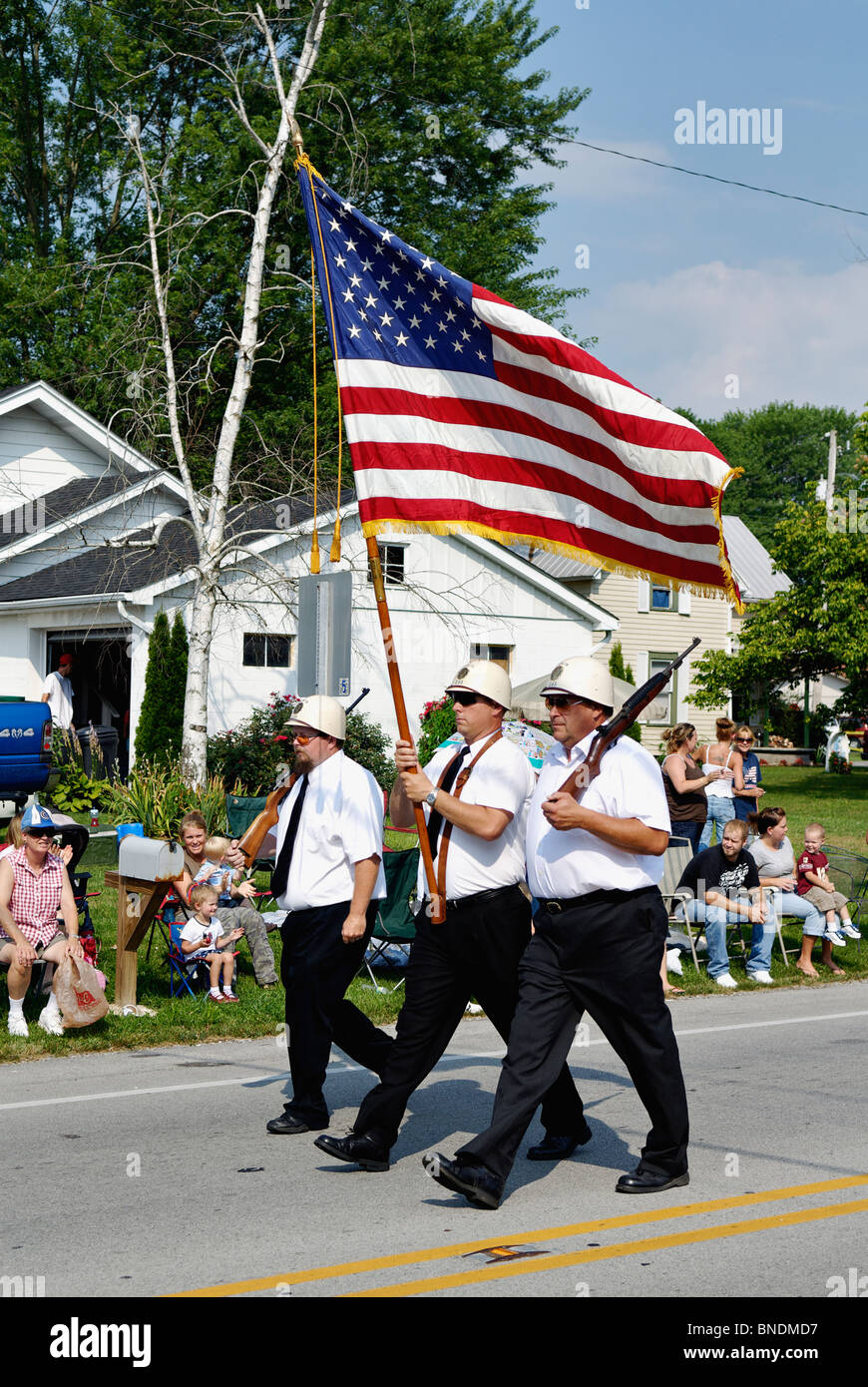 Honor Guard Carrying American Flag in Oldest Continuous Independence Day Parade in America in New Pekin, Indiana - Stock Image