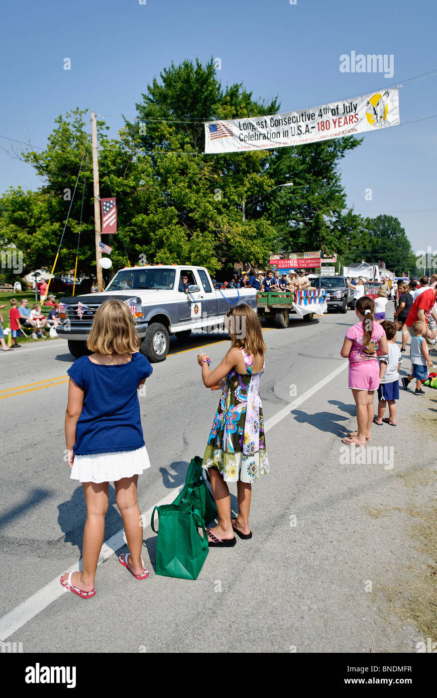 Young Girls Watching the Oldest Continuous Independence Day Parade in America in New Pekin, Indiana - Stock Image