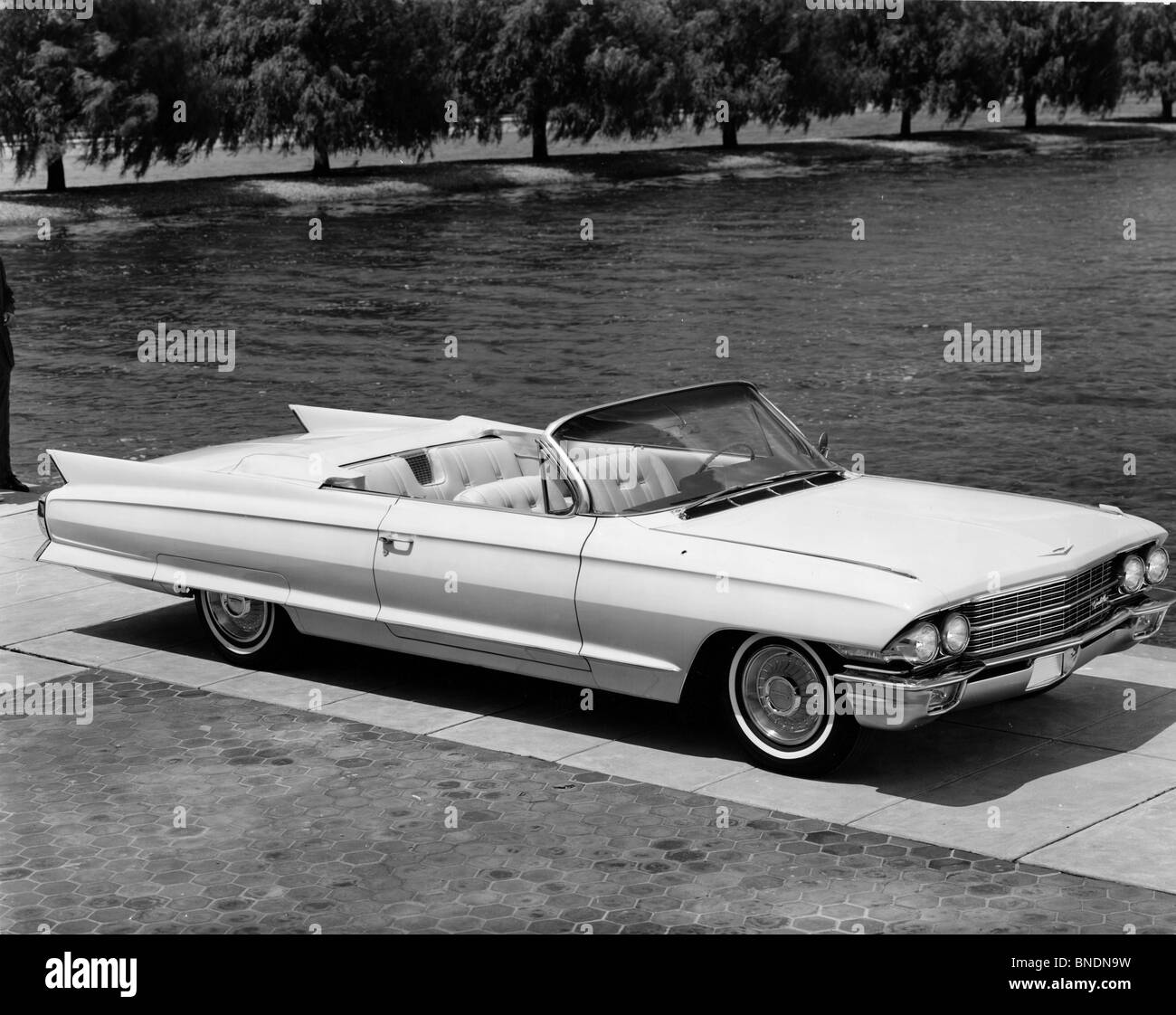 High angle view of a convertible car parked near lake, 1962 Cadillac Series 62 - Stock Image