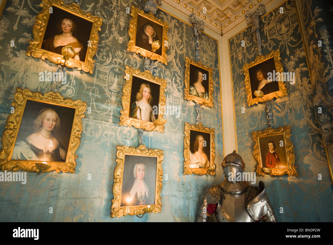Picture frames and a suit of armor a room, Blue Room, Warwick Castle, Warwick, Warwickshire, England - Stock Image