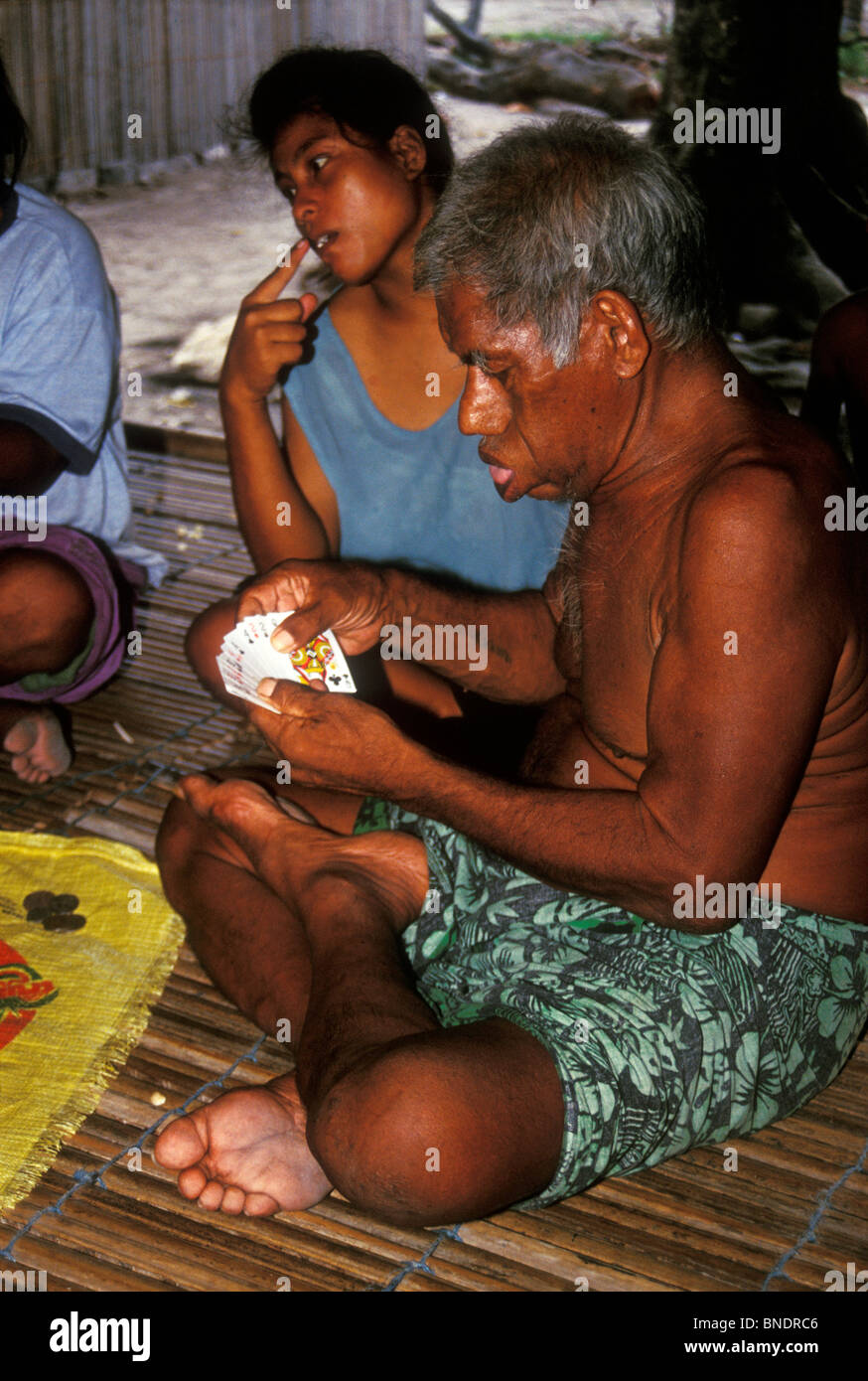 Evening card game at a remote village on Tarawa, Kiribati, Central Pacific - Stock Image