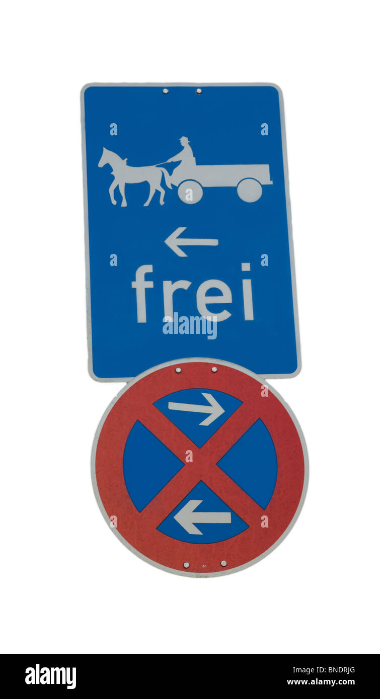 Road sign in Garmisch Bavaria Germany, No stopping or standing on the roadway in either direction, horse drawn carriages - Stock Image