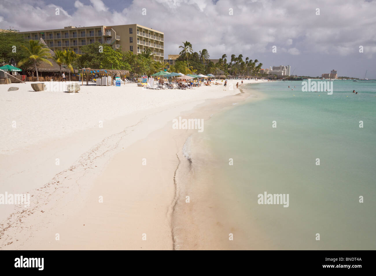 Beautiful calm blue waters at beach in Aruba - Stock Image