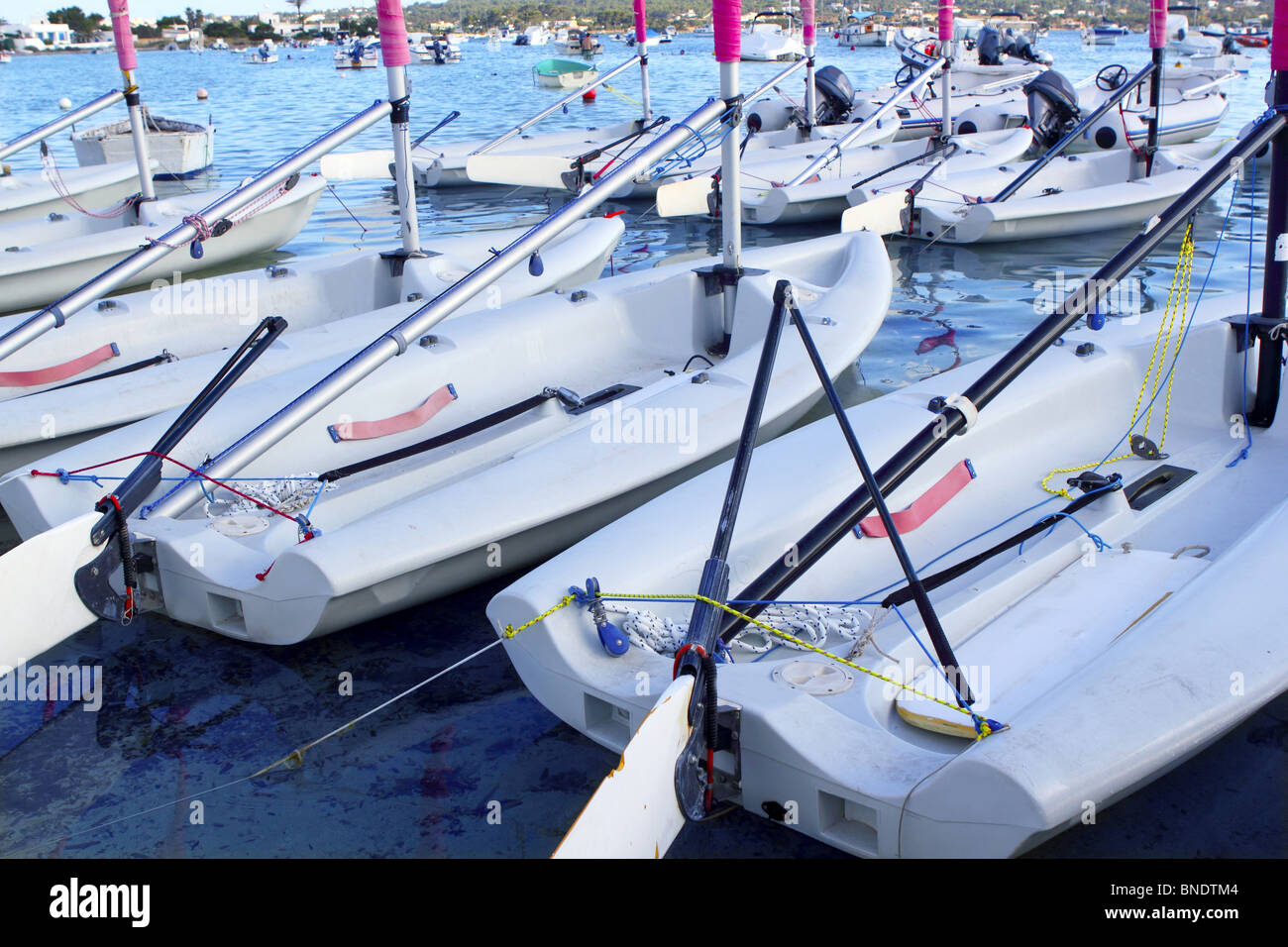 Laser little sailboats row in Formentera Balearic islands - Stock Image