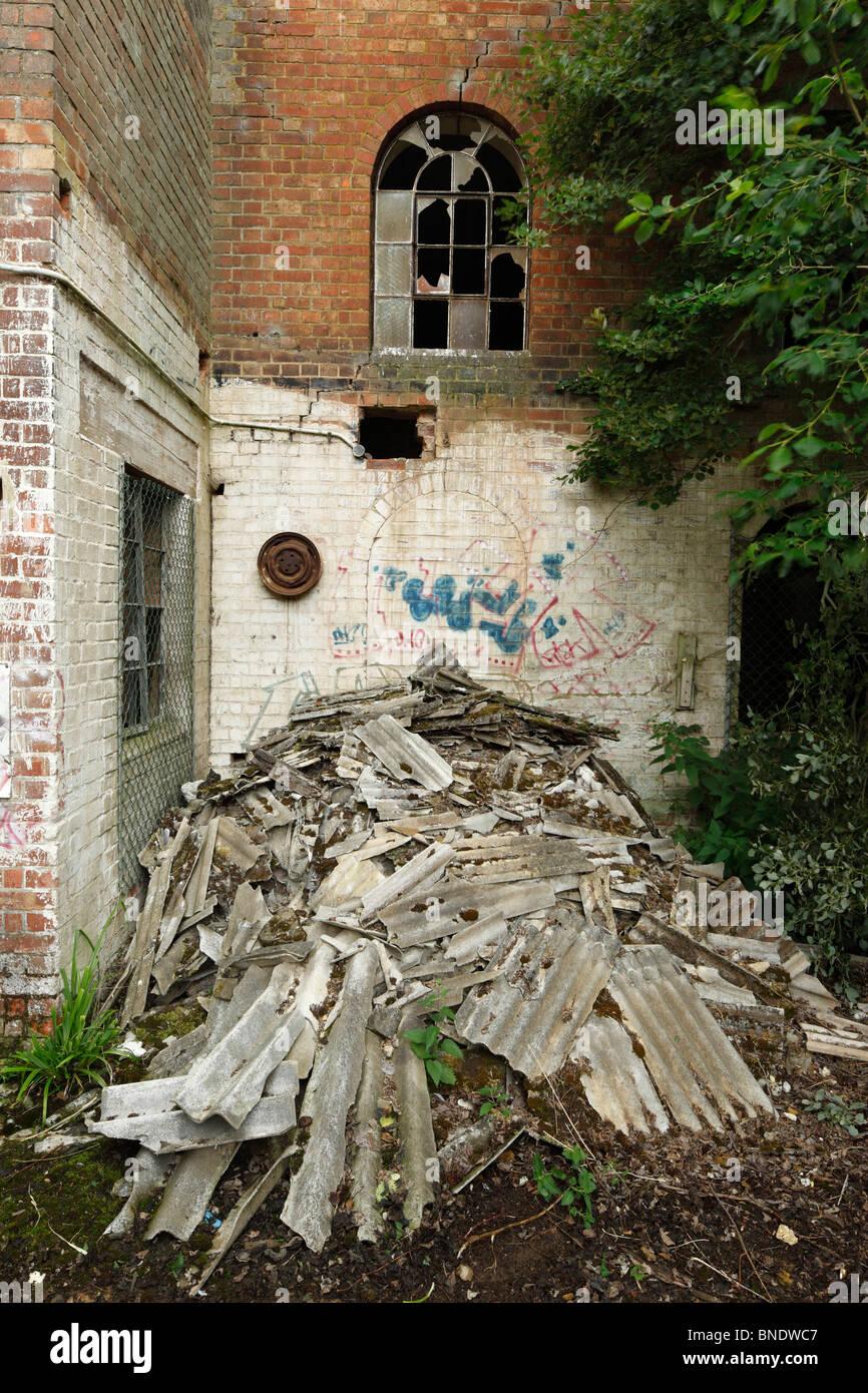 Pile of dumped corrugated Asbestos. - Stock Image