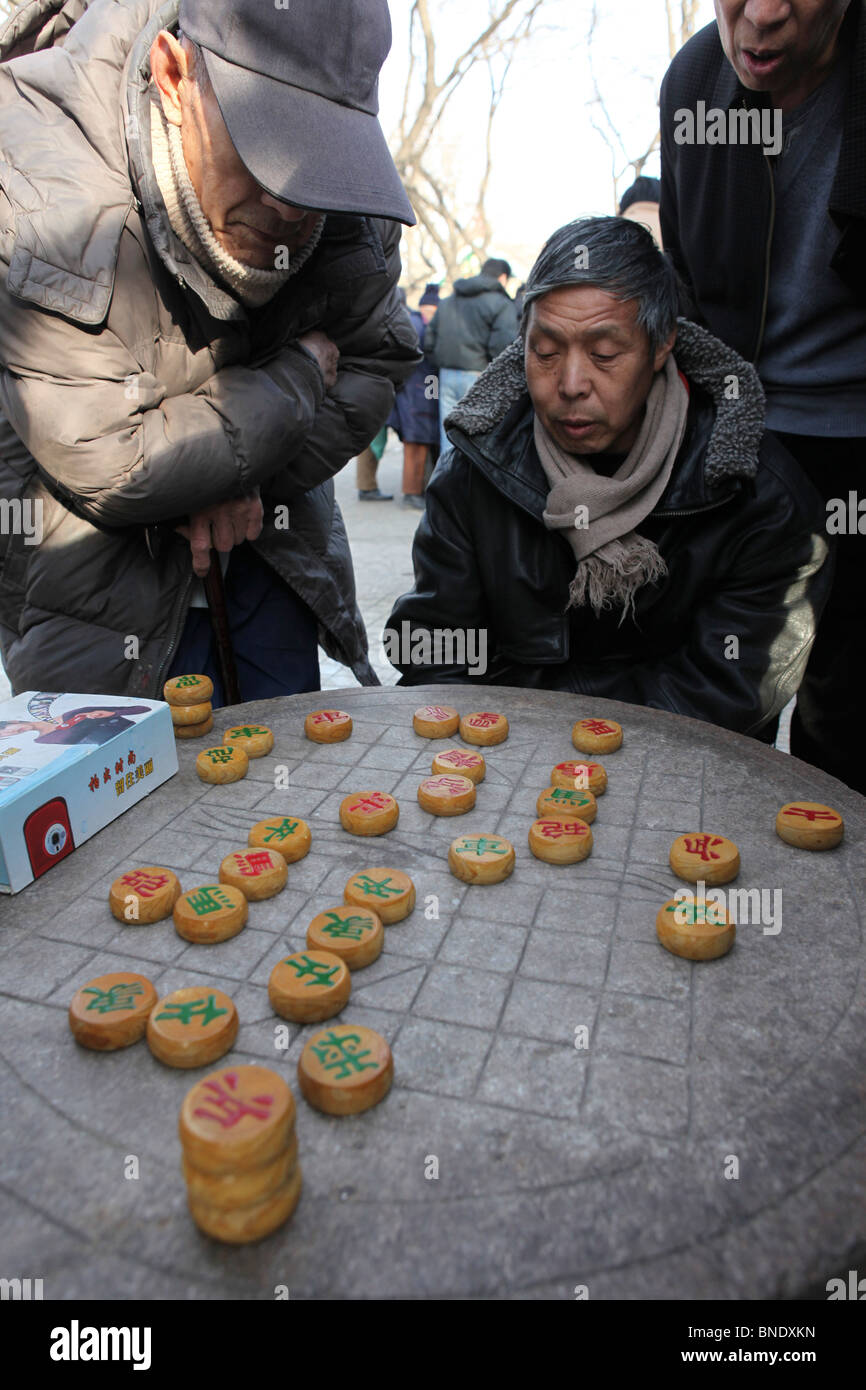 China, Beijing, xiangqi (Chinese Chess) players in a park - Stock Image