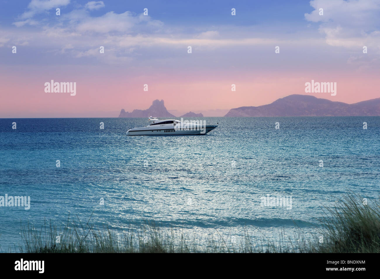 silver turquoise Illetes Formentera sea sunset magic evening light - Stock Image