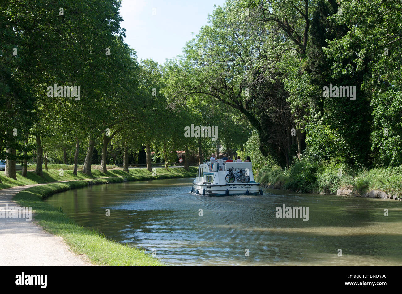 Canal du Midi in Languedoc Rousillon, France, Europe - with barge canal boat - Stock Image