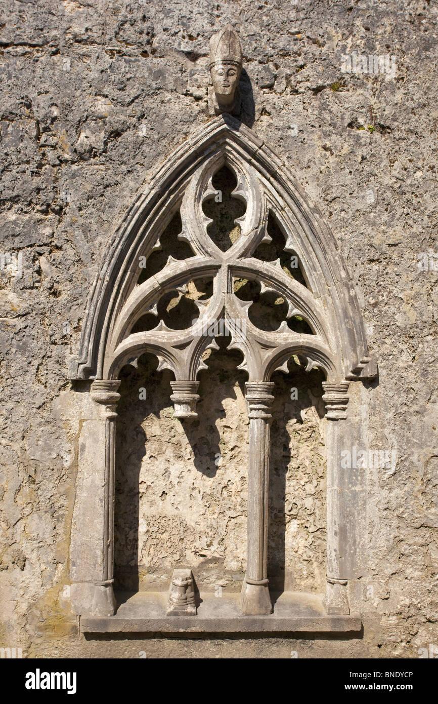 Carved head bishop Kilfenora Church Burren Ireland - Stock Image