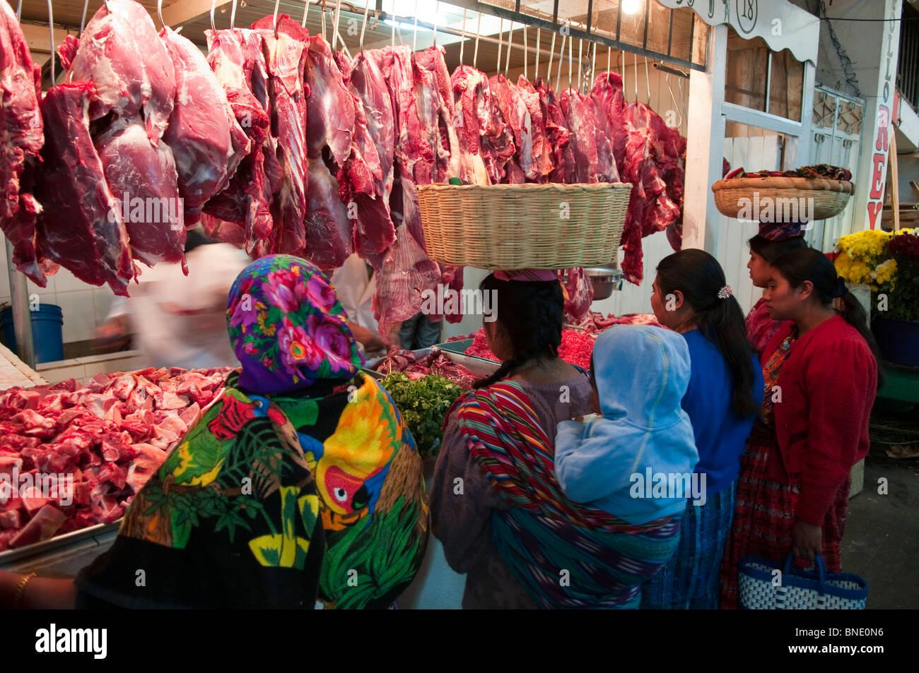 Customers at a butcher's shop, Totonicapan, Guatemala Stock Photo