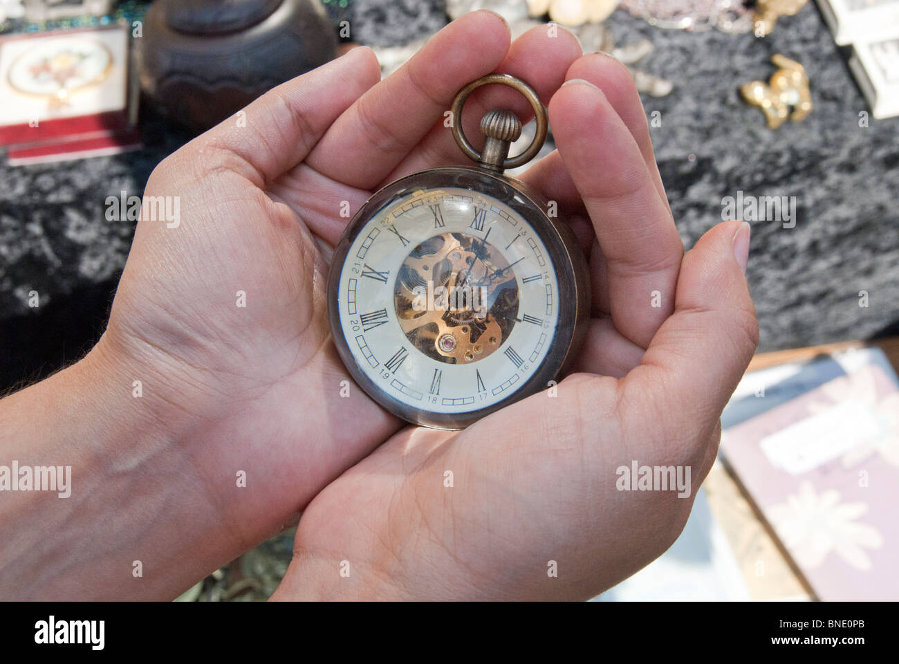 FEMALE HAND HOLDING THE ANTIQUE WATCH - Stock Image