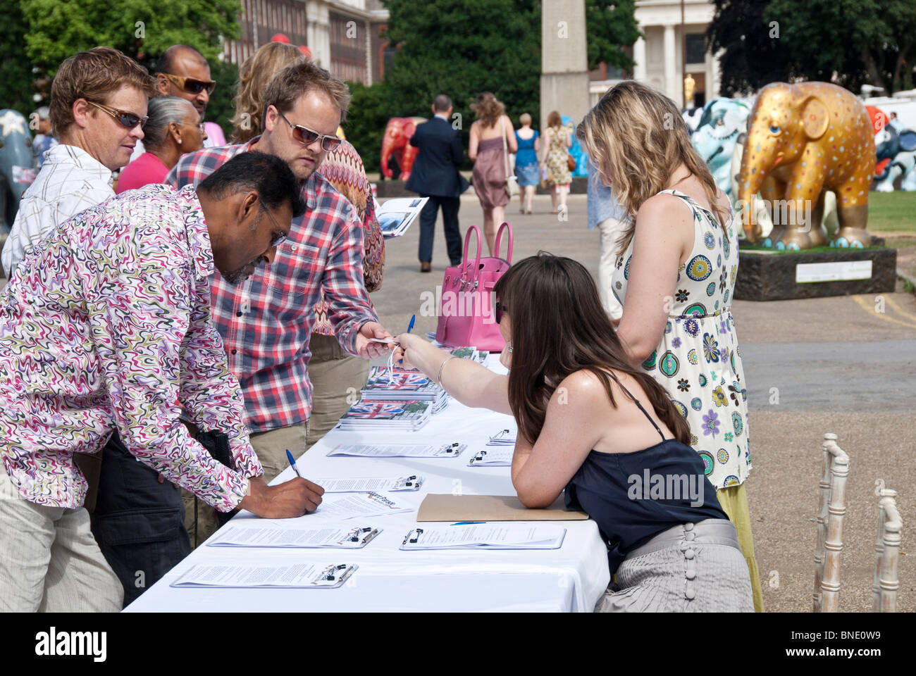 DURING THE CHARITY EVENT PUBLIC SIGNING THE SUPPORT DOCUMENTS - Stock Image