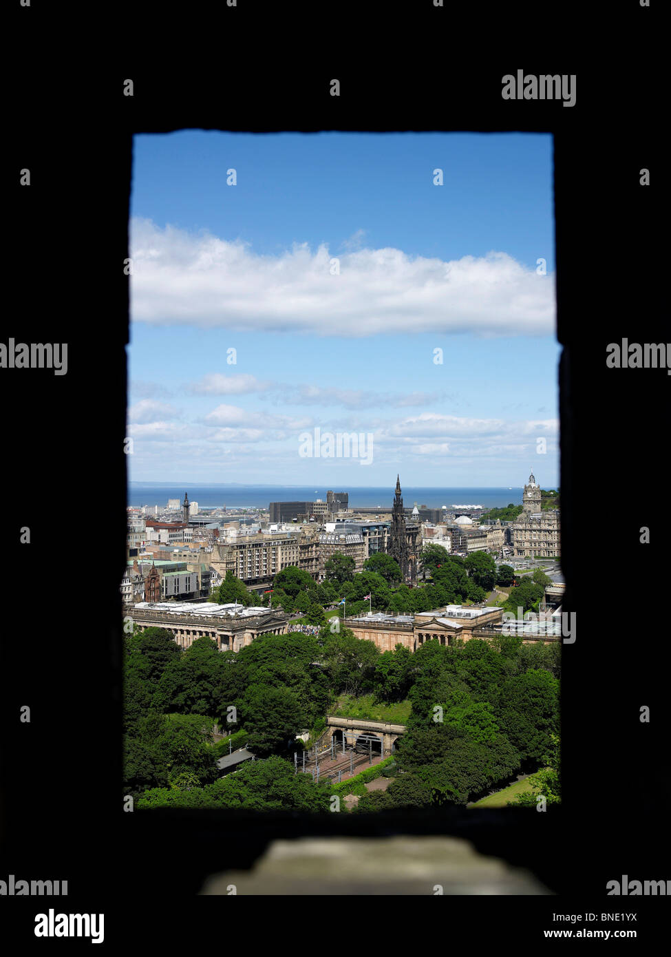 The View from Edinburgh Castle, shot through a gun emplacement, Edinburgh, Scotland, with the National Gallery Stock Photo