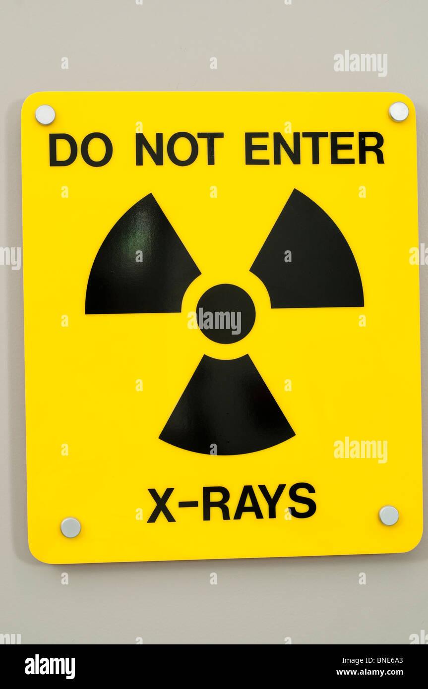 yellow xray sign on door - Stock Image