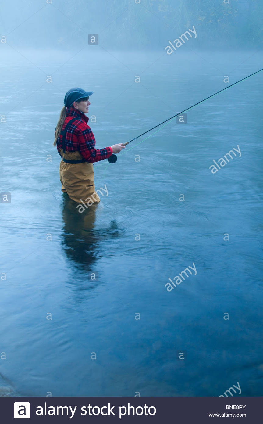 Woman fly-fishing in a river, McKenzie River, Hendricks Bridge County Park, Lane County, Oregon, USA - Stock Image