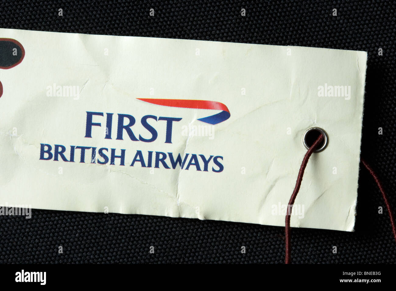 british airways first class flight luggage label - Stock Image