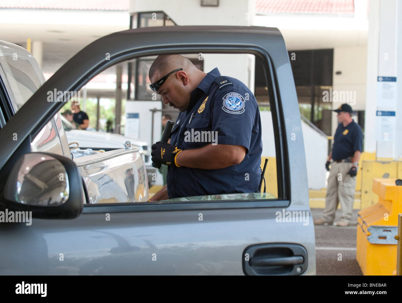 U S Customs Agent Searches A Vehicle Headed To Mexico At The Laredo