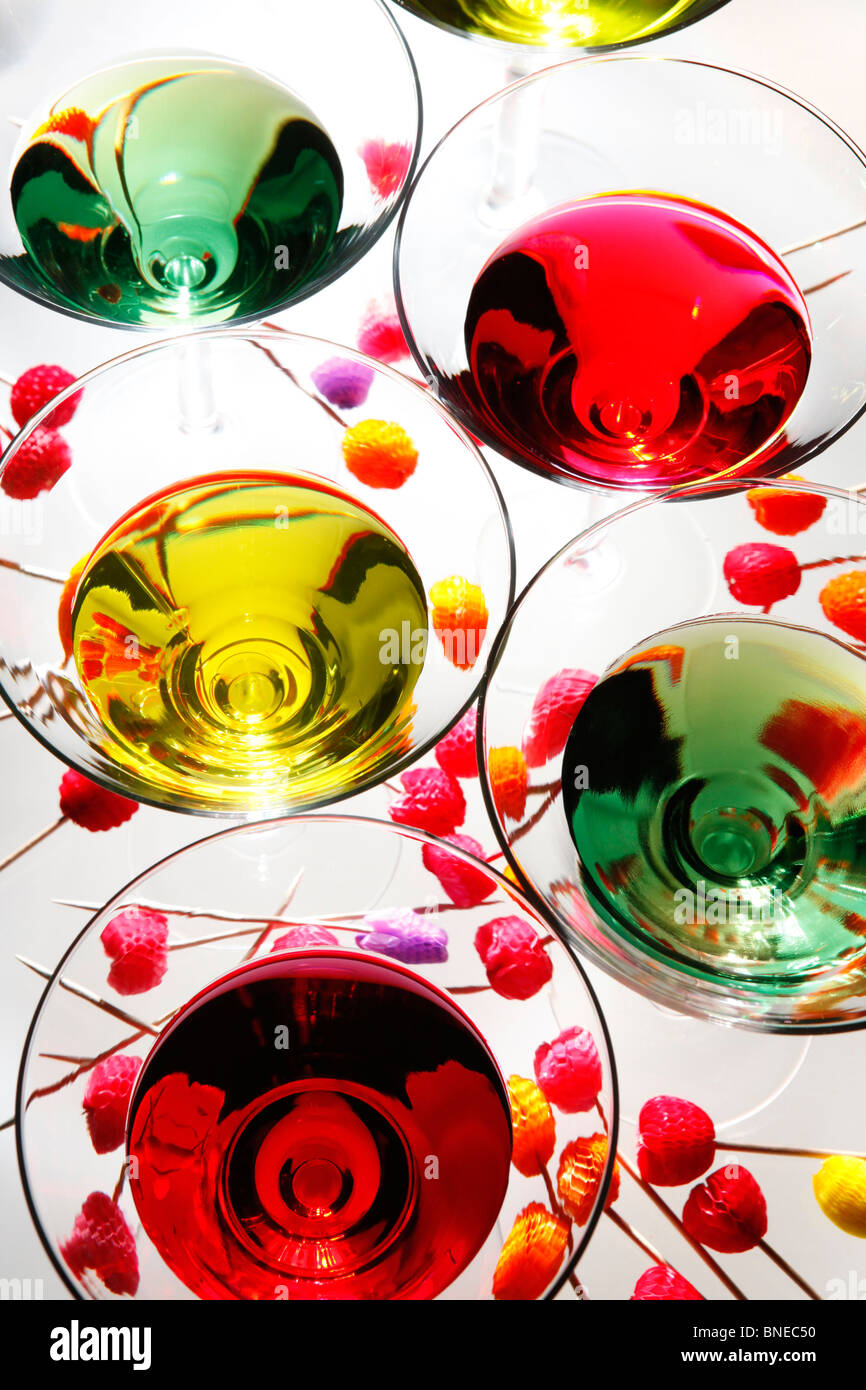Multicolored martinis and party picks - Stock Image