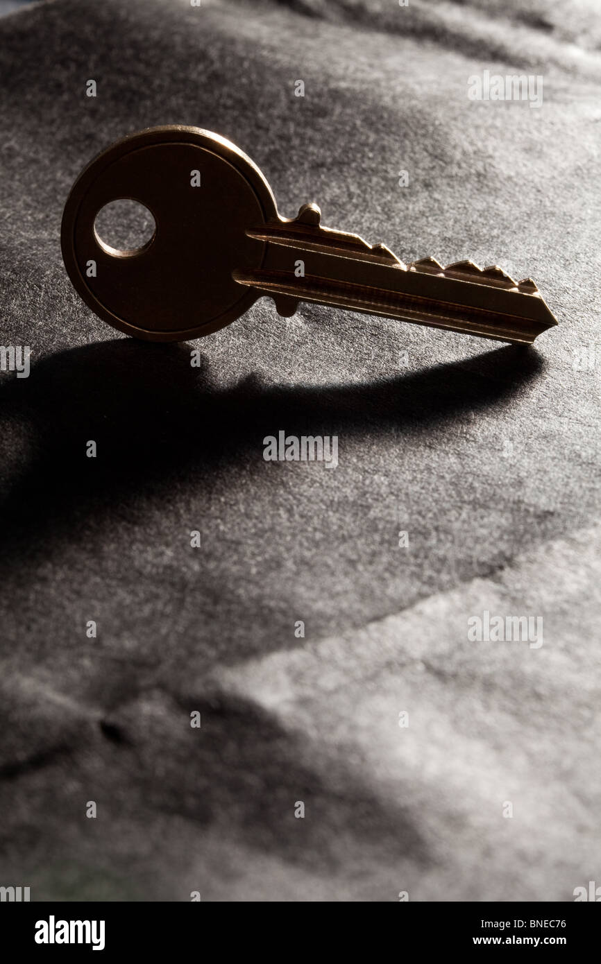 Golden House Key with black background - Stock Image