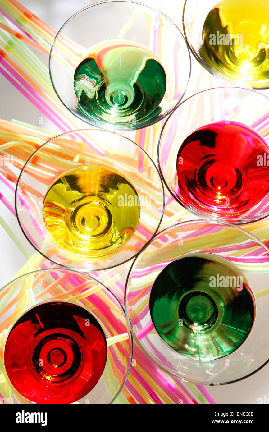 Multicolored martinis and colorful straws - Stock Image