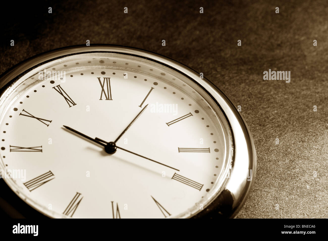 Clock close up with dark background - Stock Image