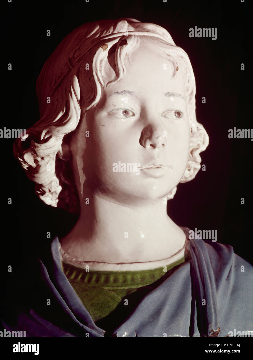 Bust of Boy by Andrea Della Robbia, glazed terracotta, (1435-1525) - Stock Image