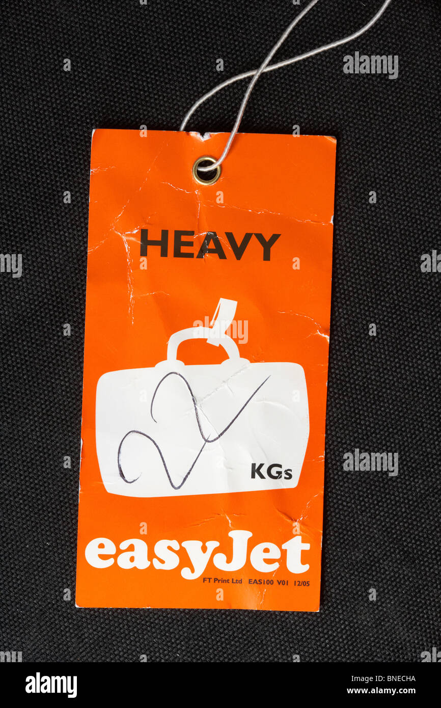 easyjet overweight heavy 22 kgs flight luggage label - Stock Image