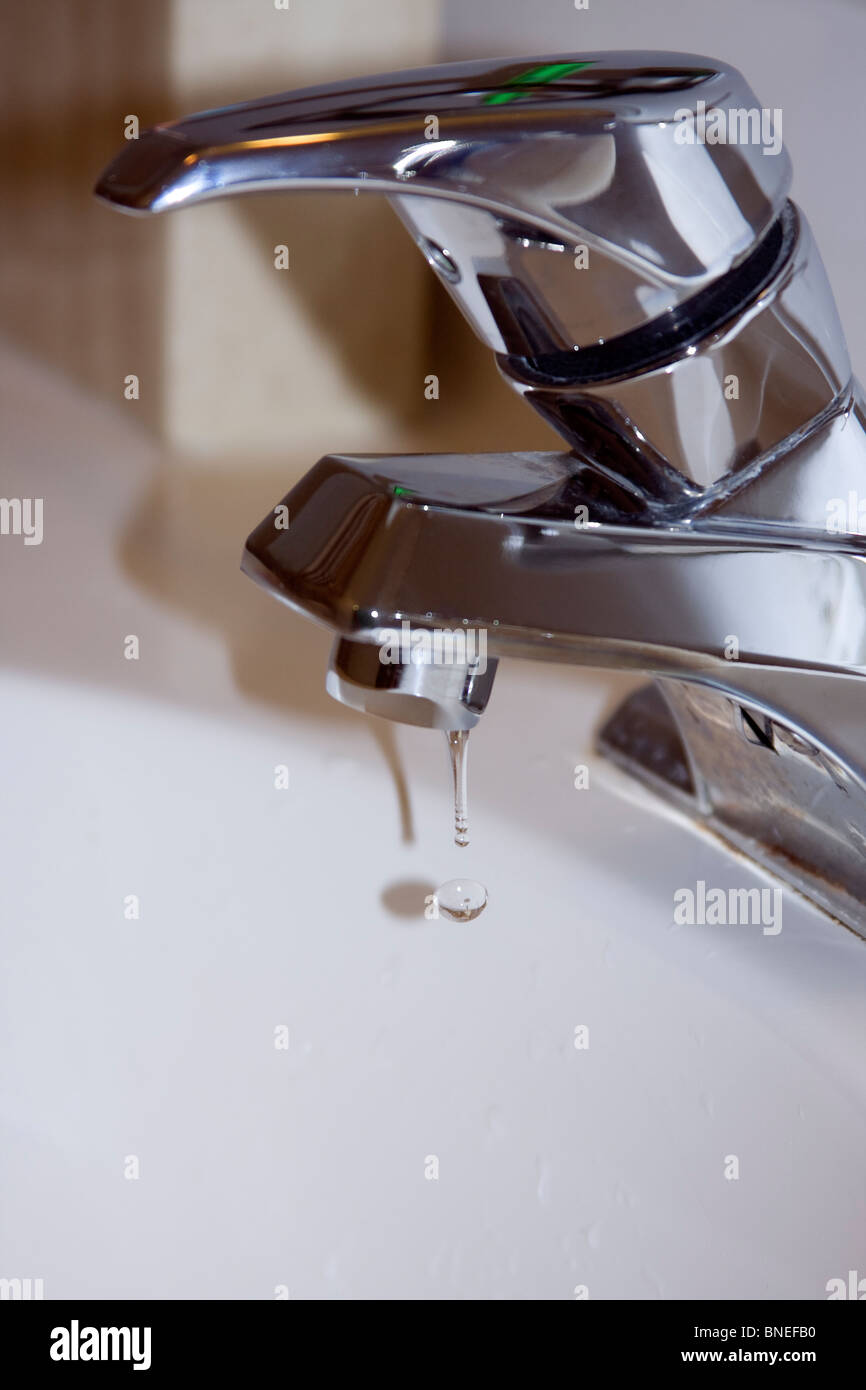 Dripping Faucet in Bathroom. - Stock Image