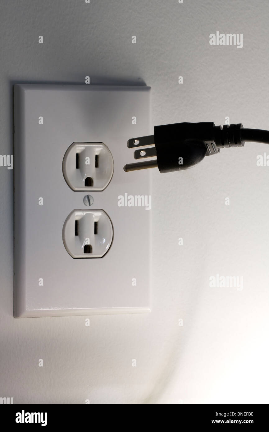 American Three Pronged Plug hovering in front of a 110 Volt A/C ...