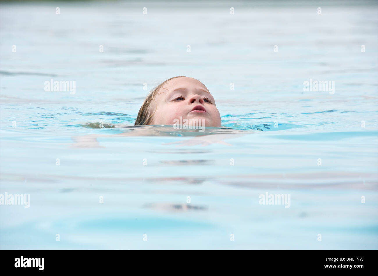 six year old girl struggling to keep her head above water in
