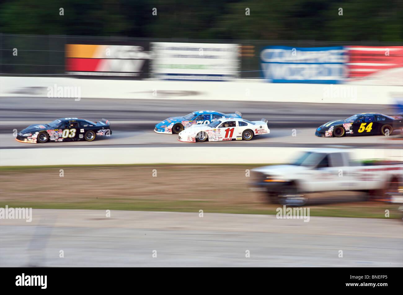 Cars racing On circuit at Nascar Racing in Houston, Texas, USA - Stock Image