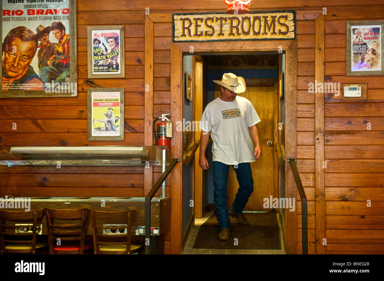 John Wayne poster in a Spanish restaurant in Hill country, Texas, USA - Stock Image