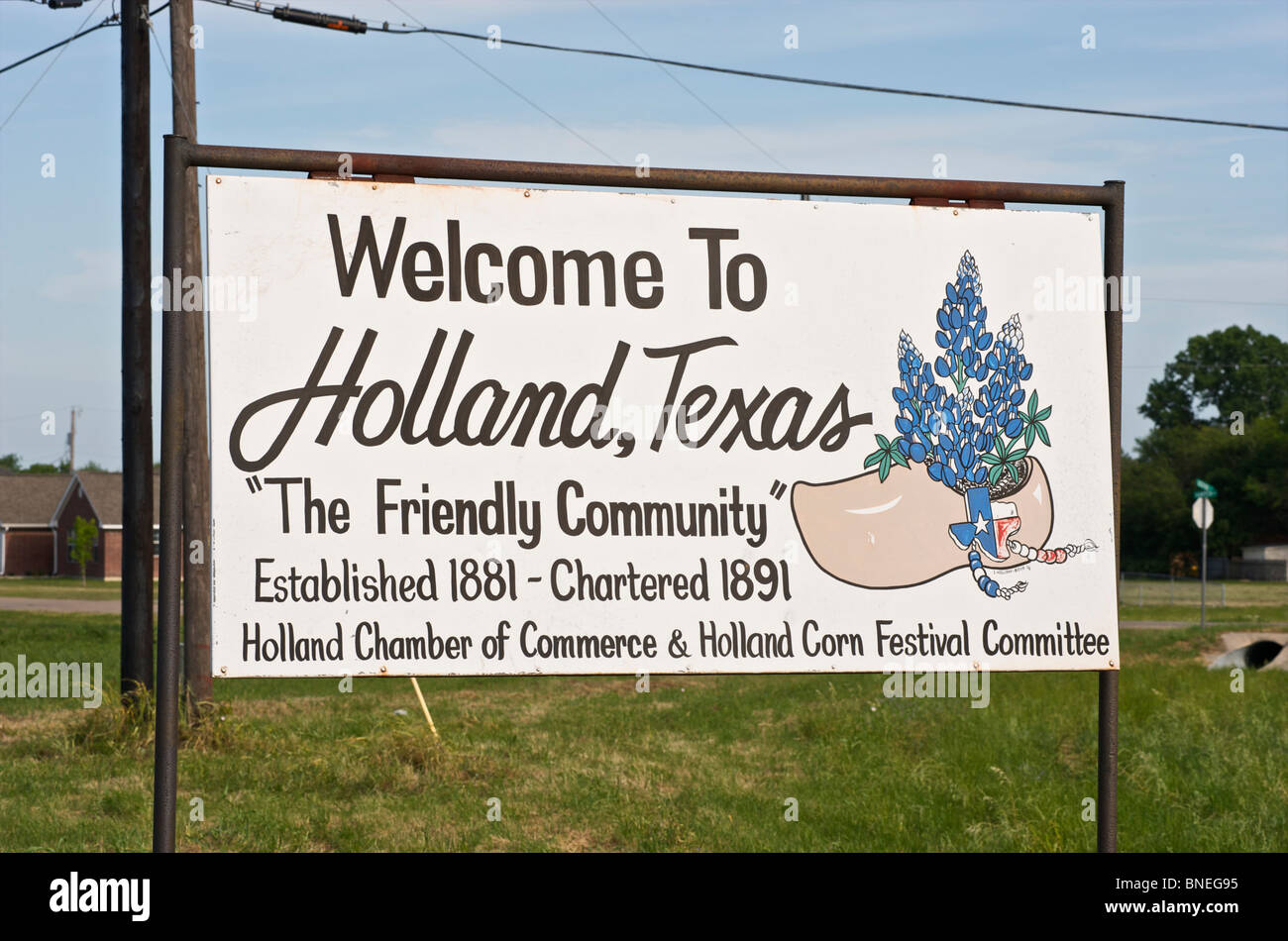 Welcome sign with wooden shoe symbol town of Holland, Texas, USA Stock Photo