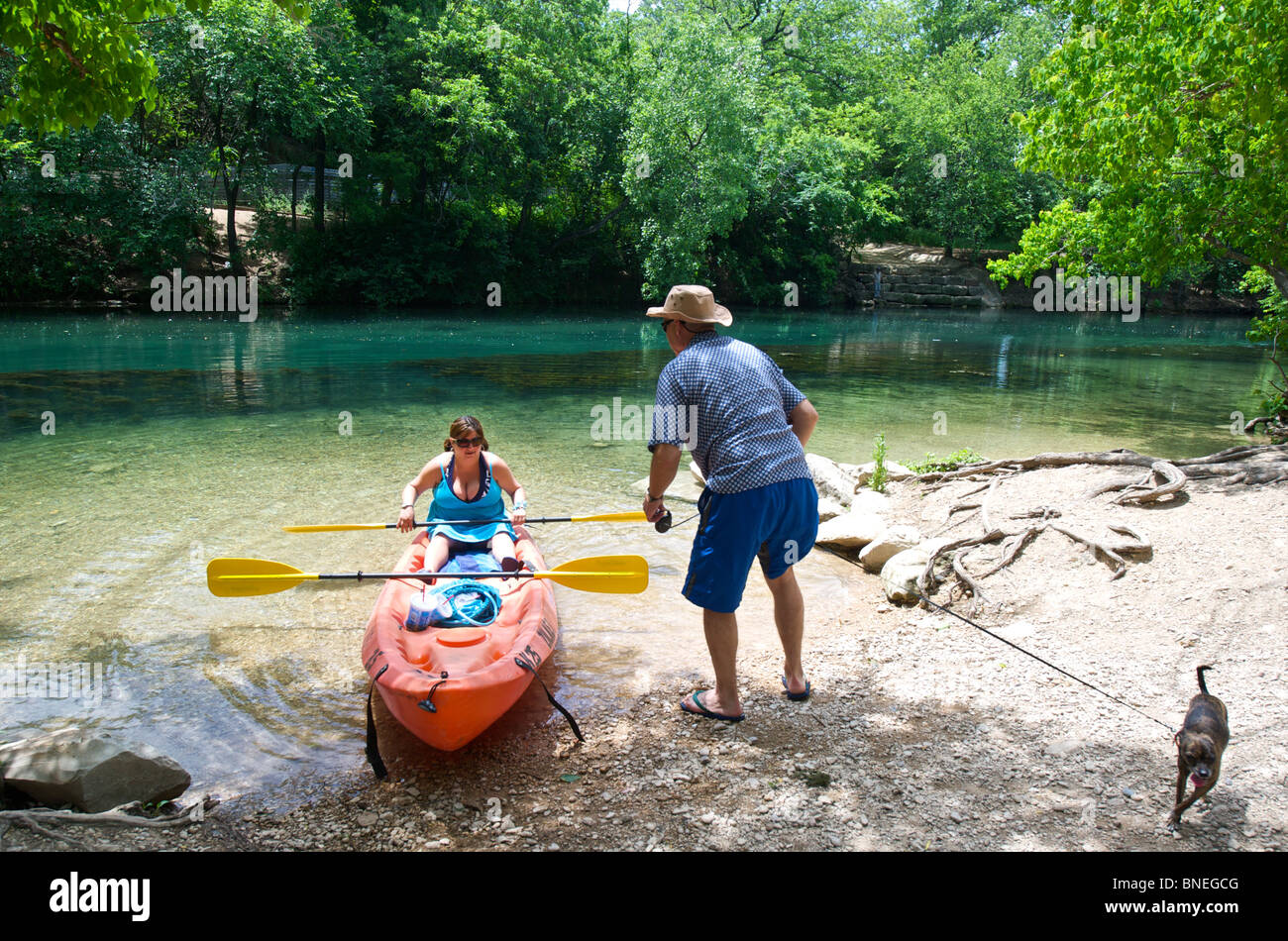 Couple rented canoe on Colorado River in Zilker Park, Austin, Texas, USA - Stock Image