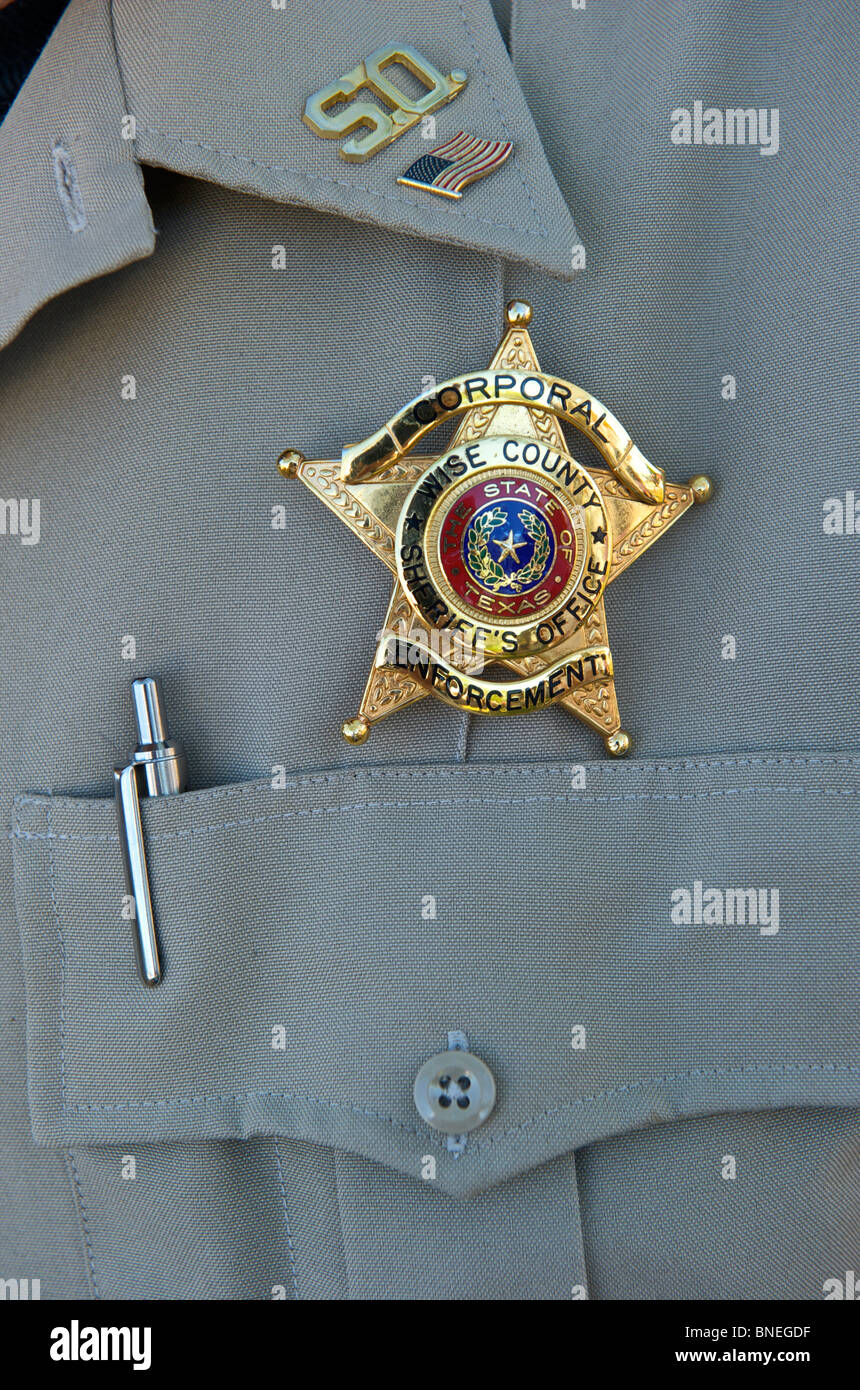 Insignia fasten into corporal's uniform signifying his official position in USA Stock Photo