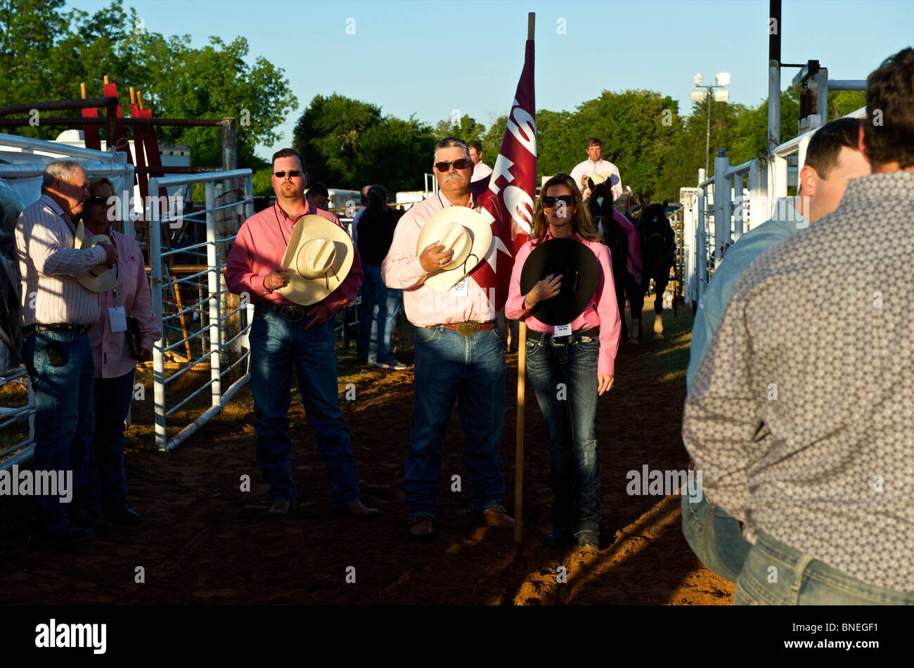 Members of PRCA rodeo singing their national anthem in Smalltown, Bridgeport, Texas, USA Stock Photo