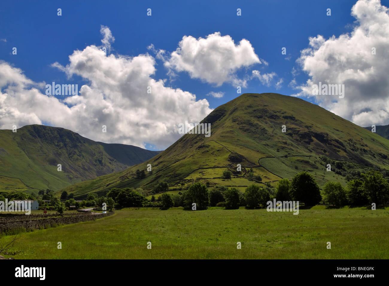 Hartsop Dodd and the hamlet of Hartsop, Cumbria. Sheep pastures and a small village at the base of the Kirkstone - Stock Image