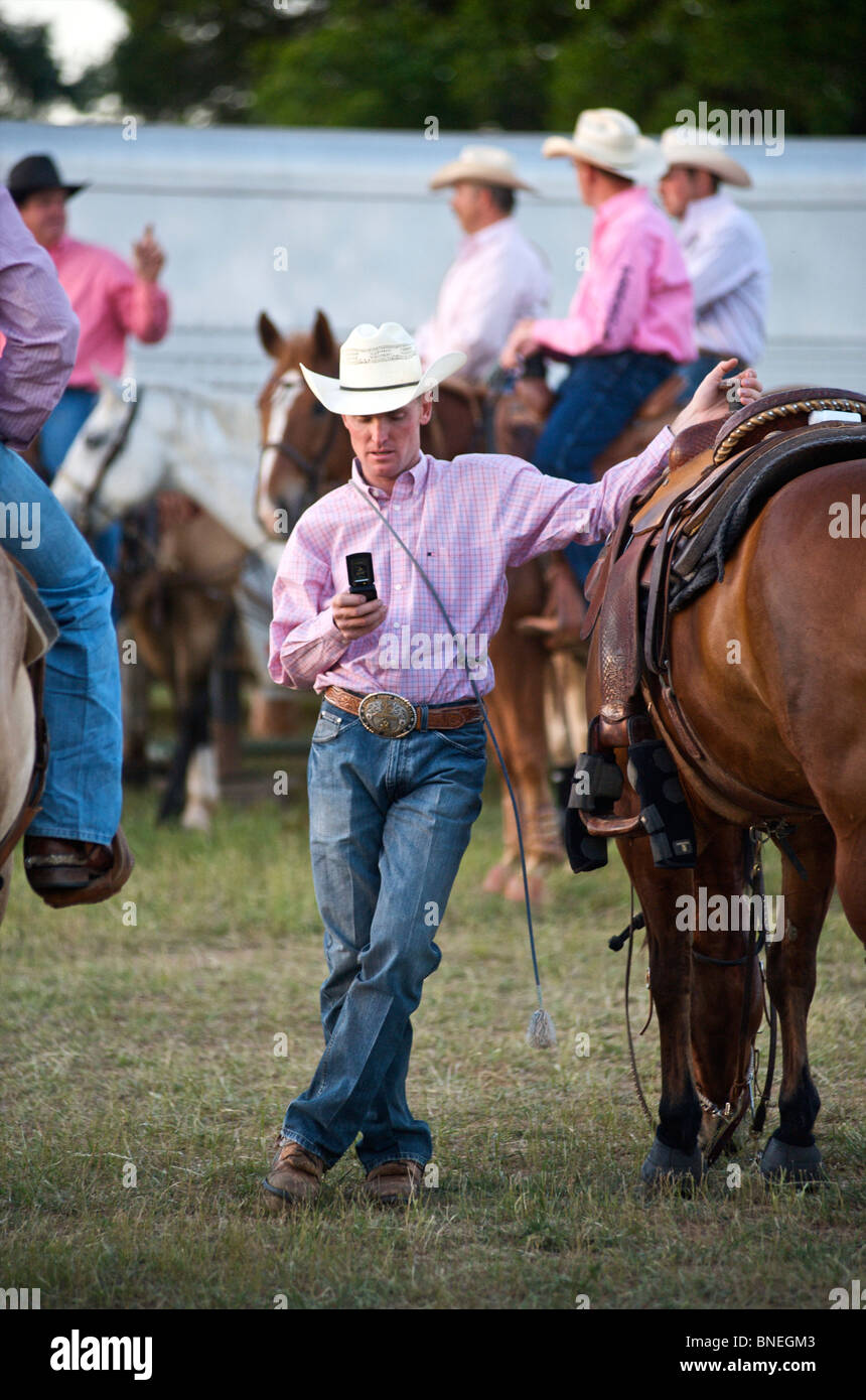 Cowboy members of  PRCA standing backstage at rodeo event in Bridgeport  Texas, USA Stock Photo