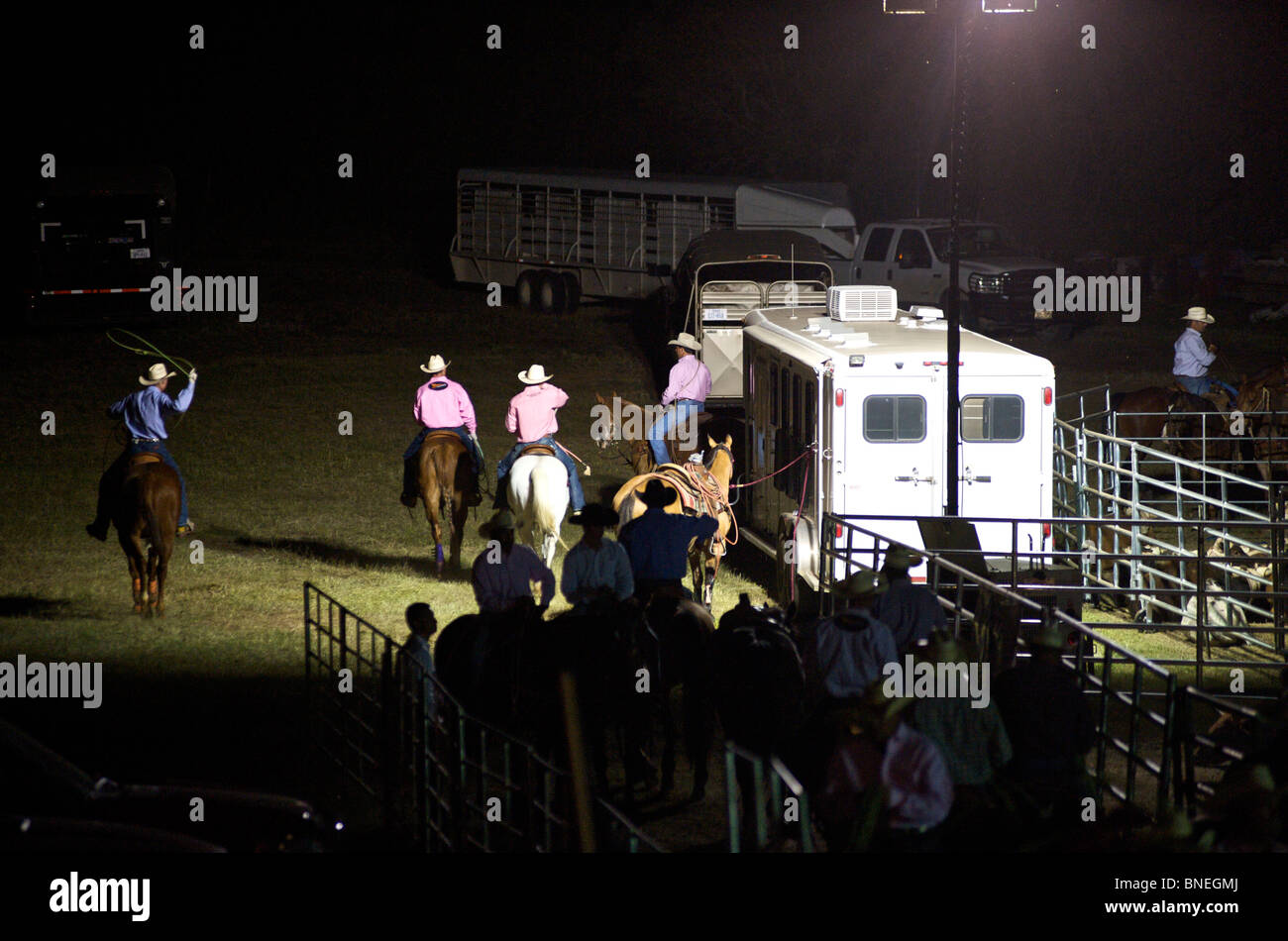 Cowboy members of PRCA riding horses backstage in Bridgeport  Texas, USA Stock Photo