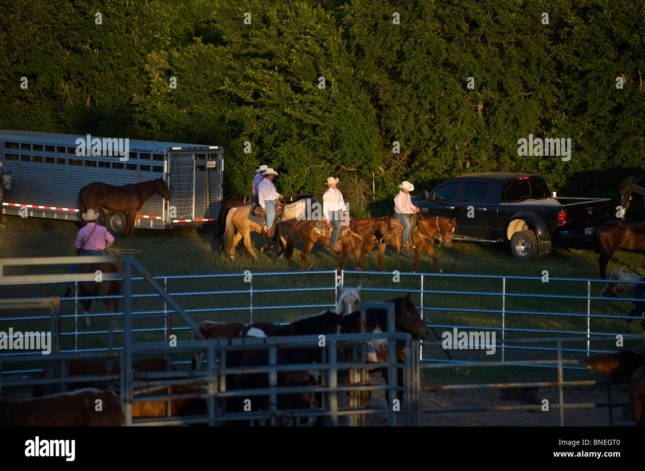 Cowboy members of PRCA riding horses backstage at rodeo event in Bridgeport, Texas, USA Stock Photo
