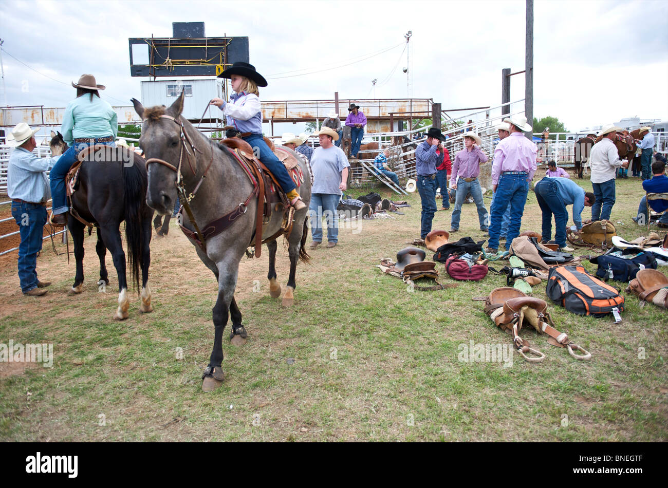 Cowgirl riding horse backstage at PRCA rodeo event in smalltown Bridgeport, Texas, USA Stock Photo