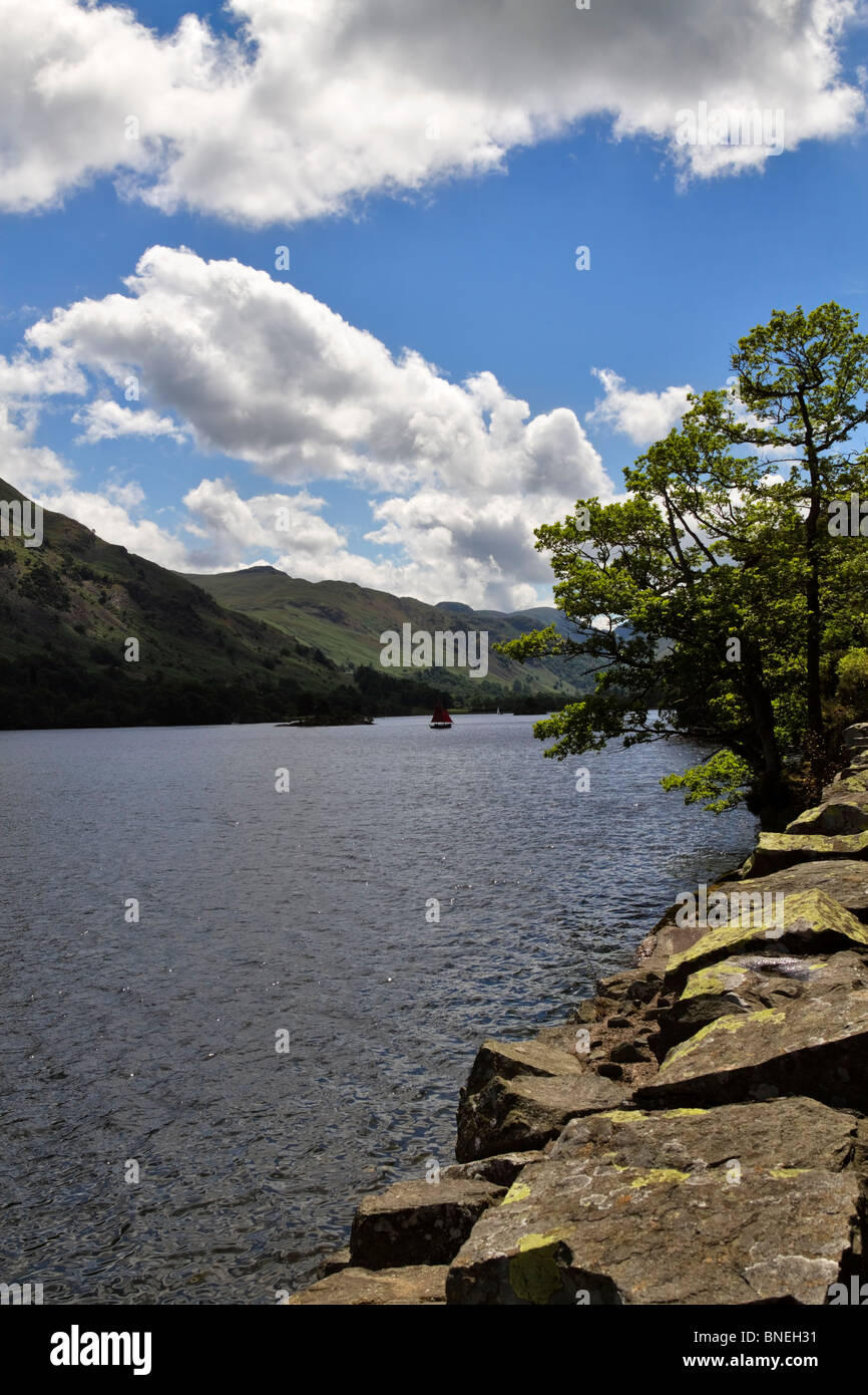 A stone wall at the edge of the lake, Ullswater, Lake District, Cumbria - Stock Image