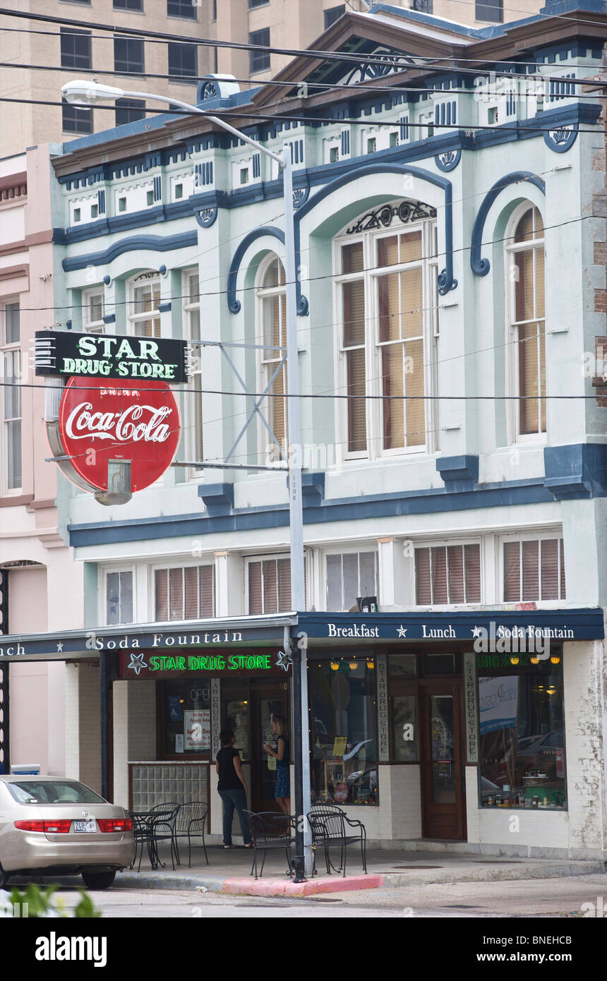 Famous star drug store with the oldest Coca Cola neon sign downtown in Galveston, Texas, USA - Stock Image
