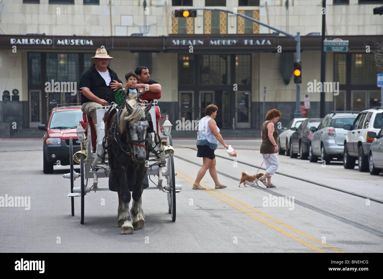 Family riding on horse cart downtown in Galveston, Texas, USA Stock Photo