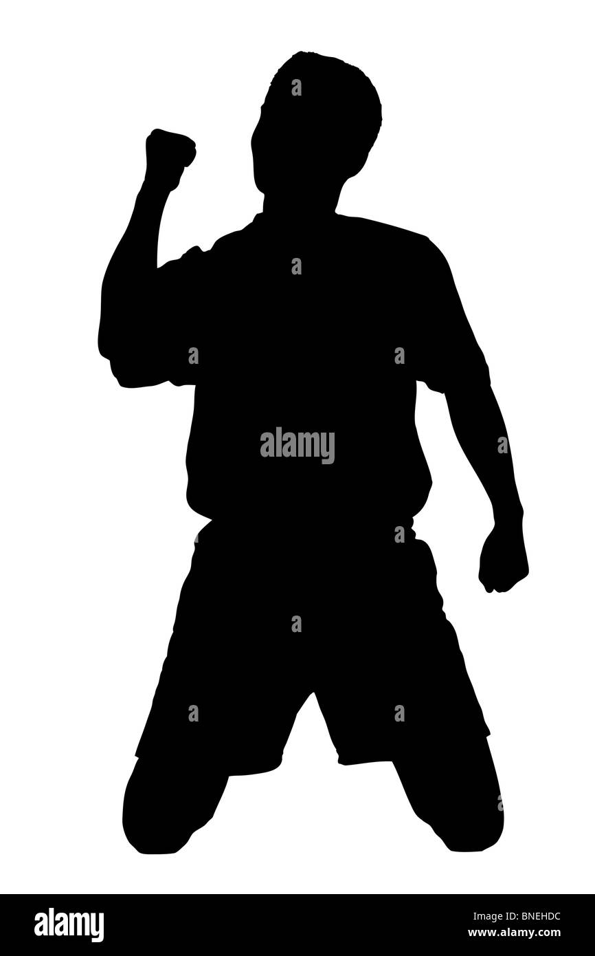 A silhouette of a soccer player - Stock Image